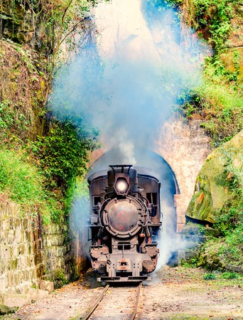 Steam narrow-gauge train moves from Yuejin to Bagou through the tunnel. Jiayang Mining Region. Sichuan province. China.