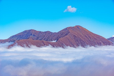 foggy hill: Clouds cover mountain tops at autumn evening time. Caucasus. Russia. Stock Photo