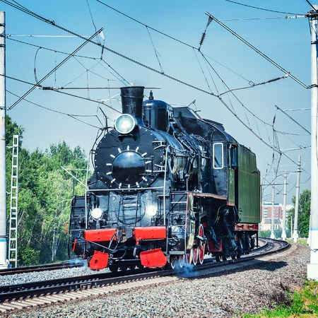 Steam train moves toward in the Moscow region. Stock Photo
