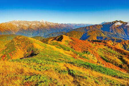 withering: Fantastic mountain tops at autumn evening time. Caucasus. Russia.