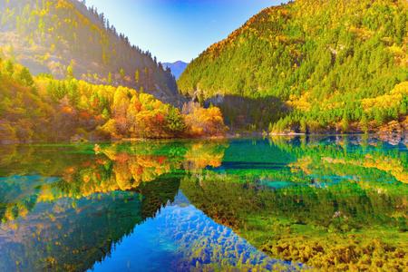 Five Flower Lake at autumn sunrise time. Jiuzhaigou nature reserve, Jiuzhai Valley National Park, China Stock Photo