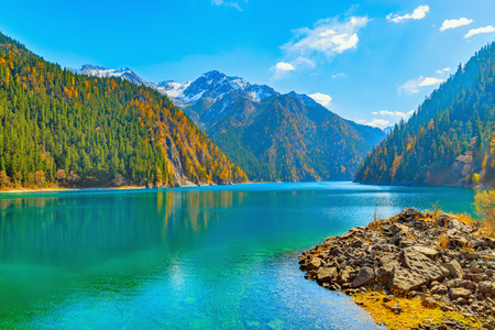 View of Long Lake at autumn day time. Jiuzhaigou nature reserve, Jiuzhai Valley National Park, China.