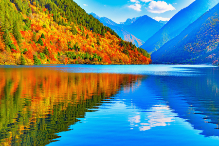 View of the lake at autumn sunset time. Jiuzhaigou nature reserve, Jiuzhai Valley National Park, China.