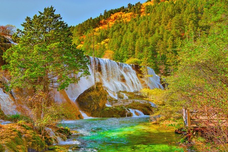 tibetian: Autumn view of Pearl Shoals waterfall with pure water. Jiuzhaigou nature reserve, Jiuzhai Valley National Park, China. Stock Photo