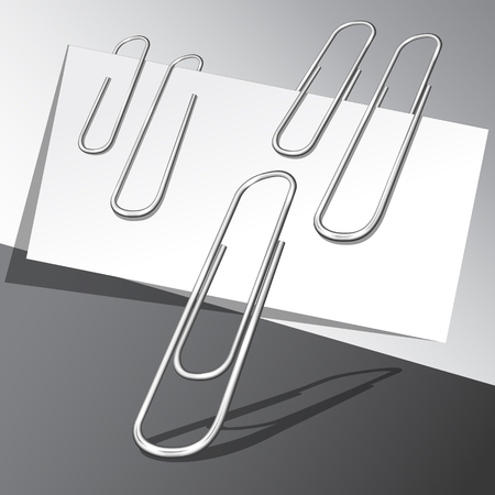 Five paper clips and paper sheets on gray background.