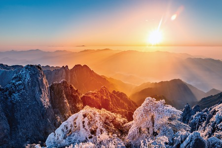 Sunrise above the mountain peaks of Huangshan National park. China. Stock Photo