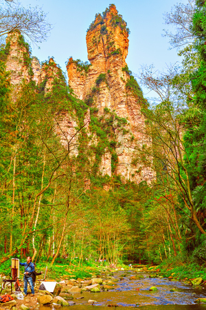 Zhangjiajie Forest Park, China - November 11, 2016: Artists by the river and colorful cliffs in the national park. Editorial