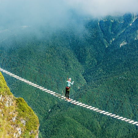 Woman crossing the abyss.
