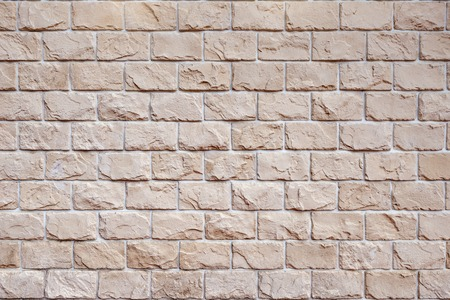 Colorful brick wall background on sunny summer day.