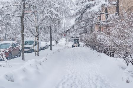 Cars under the snow on the winter city street. Stok Fotoğraf