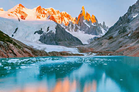 Amazing sunrise view of Cerro Torre mountain by the lake. Los Glaciares National park. Argentina Stock Photo