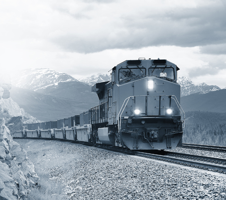 Long freight train moves through Canadian Rockies.