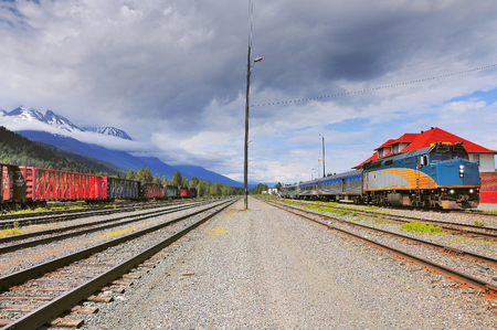 Passenger train from Prince Rupert to Prince George stands on the station for changing locomotive crew. Smithers. British Columbia. Canada.