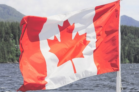 Canada flag on the Vancouver island nature background. Stockfoto