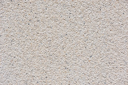 White wall background made from concrete and small stones. Stock Photo