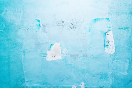 Plaster on the blue wall texture background.