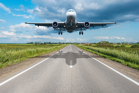 Landing of the passenger plane to the new highway.