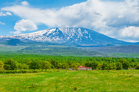 Etna volcano on rural background. Sicily. Italy. Stock Photo