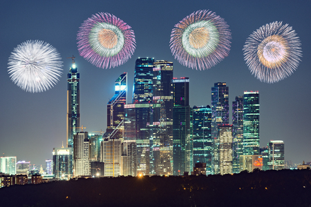 Colorful fireworks show above the evening city. Moscow. Russia