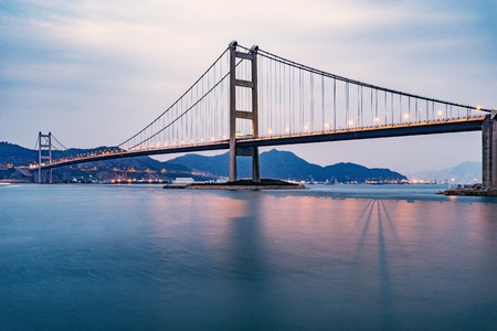 Bridge to Park island at sunset time. Hong Kong.