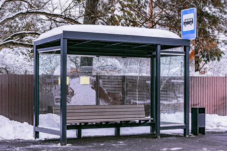 Empty bus stop at winter day time.