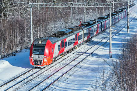 Modern high-speed train moves fast at winter morning time. Reklamní fotografie