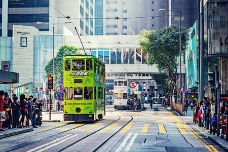 Hong Kong, China - December 10, 2016: Tramways on the central city street at day time.