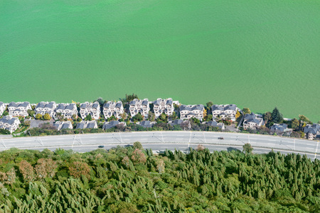 Aerial view of the road and rich houses by Dianchi lake. Kunming. China. View from West mountains.