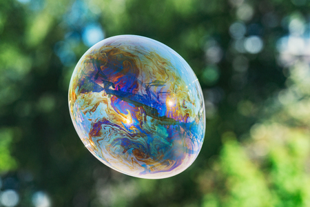 Soap bubble with rainbow colors.