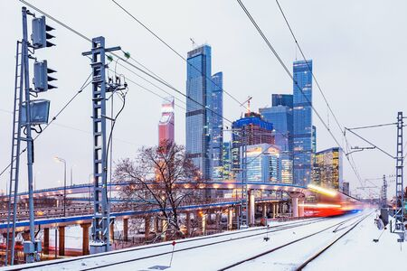 Modern high-speed train arrives to the station at winter evening time. Moscow. Russia. Imagens