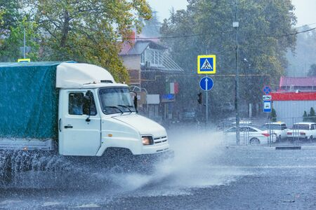 Driving car on flooded road during flood caused by torrential rains. Sochi. Russia.