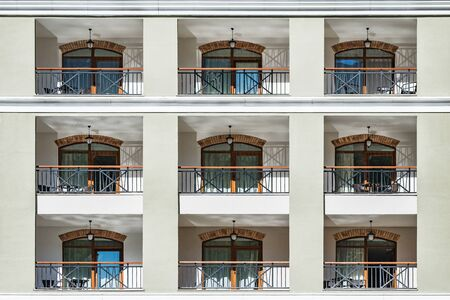 Windows and balconies of the new building at day time. Imagens