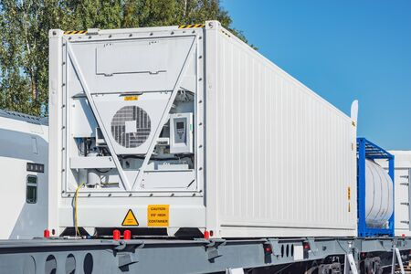 Refrigerated container 20-foot-long on the railway platform.