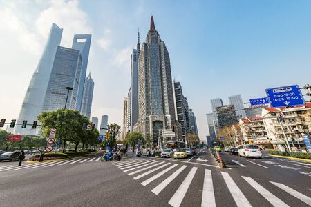Shanghai, China - December 31, 2016: Crossroads and streets in the city center at day time.