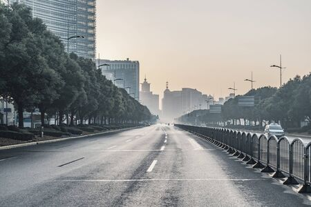 Long morning street in Shanghai city in the morning. China. Imagens