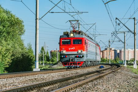 Freight locomotive approaches to the station at evening time. Editoriali