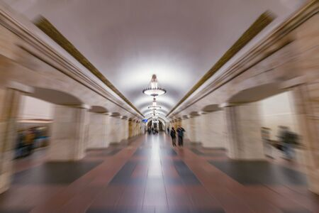 Blurred image of the metro station interior at evening time.
