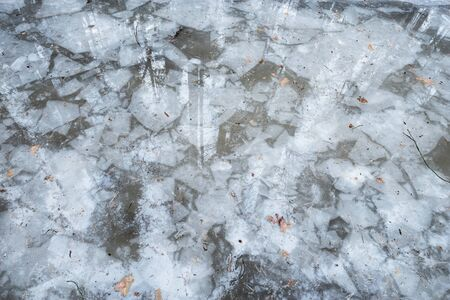 Pieces of the ice in the lake water.