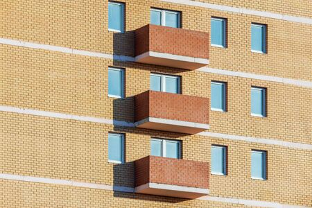 Windows and balconies of the residential modern building. Imagens