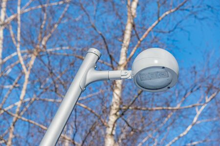 Metal white lantern in the winter city park.