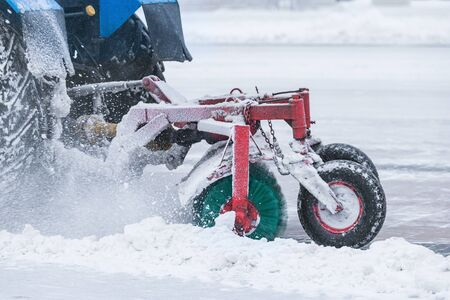 Part of the working snow cleaner on the street at winter time.