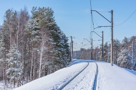 Railway track at cold winter day time. Imagens