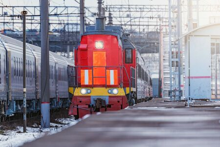 Passenger train approaches to the station platform at evening time. Moscow. Rusia.