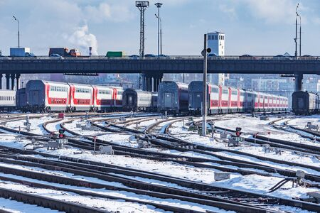 Passenger carriages stand by depot at winter day time. Moscow. Russia.