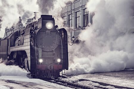 Steam train departs from Riga railway station. Moscow. Russia. Imagens