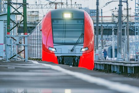 Highspeed train approaches to the station platform at evening time. Moscow. Russia. Imagens