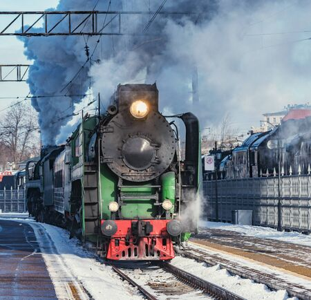Retro train departs from the railway station. Moscow. Russia. Banco de Imagens