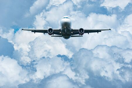 Passenger plane is ready for landing in the cloudy sky.