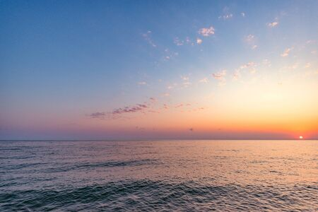 Colorful sky above the sea at sunset time. Stock Photo