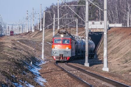 Freight train moves through the tunnel at spring day time. 写真素材